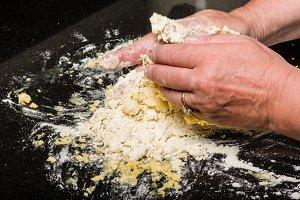 Baker forming raw pasta dough