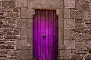 Old antique purple door and wall