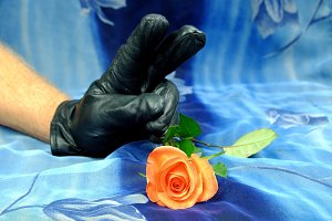 Black glove showing victory symbol