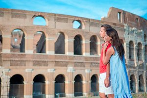 Happy family in Europe. Romantic couple in Rome over Coliseum background. Italian european vacation