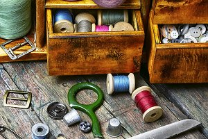 cupboard with threads and buttons