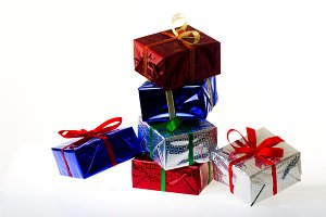 Multi-colored gift boxes on white background