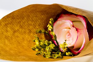 """Bouquet of flowers """"Limonium"""" and rose """"Sweetness"""" in parchment paper"""