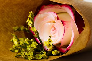 "Bouquet of flowers ""Limonium"" and rose ""Sweetness"" in parchment paper"