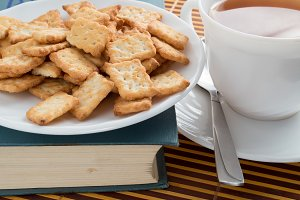 Plate with crackers and small teacup