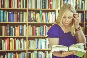 Blonde bookreader in study