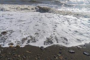 Strong surf on sandy beach.
