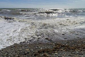 Strong surf on sandy beach. Crimea.