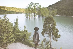 Woman staring at the lake.