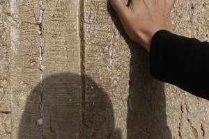 Male hand on a Western wall