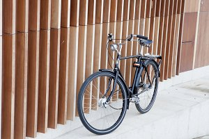 Black bicycle on a modern wall