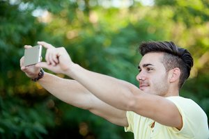 Attractive guy with the mobile