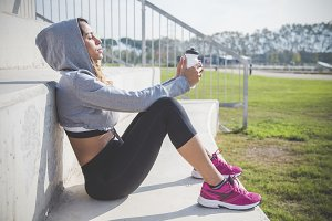 Beautiful sportswoman resting after an exercise session