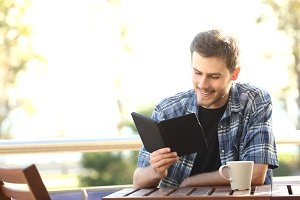 Man reading a book in an ebook