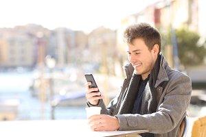 happy man using a smart phone