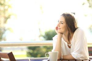 Pensive happy woman