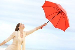 girl joking with a red umbrella
