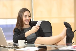 executive texting on smart phone