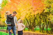 Family having fun on autumn day. Dad and kids enjoy fall