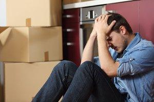 Sad evicted man worried