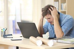 Sad freelance male worried
