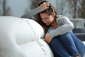 Sad girl crying desperately