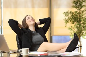 Satisfied relaxed businesswoman
