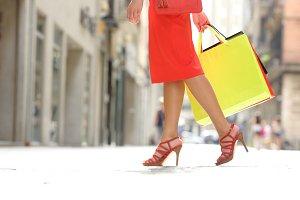 Side view of a shopper woman