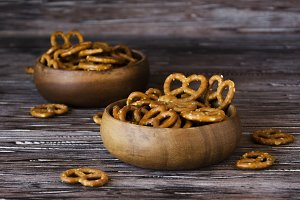 traditional pretzels in wooden bowls on a rustic table