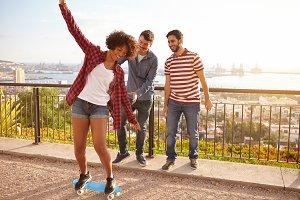 Friends having fun with Skateboard