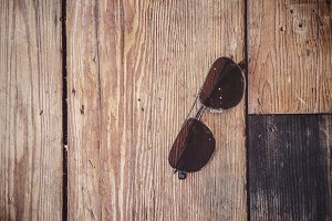 Sunglasses on Wood