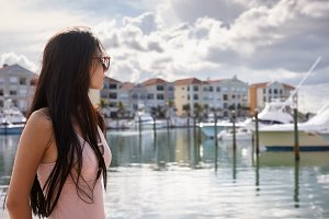 Young woman in a yacht harbour