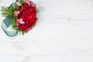 Bridal bouquet on wood surface