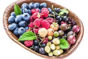 Berries in the wooden bowl