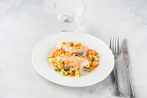 Steamed salmon with vegetables on white plate