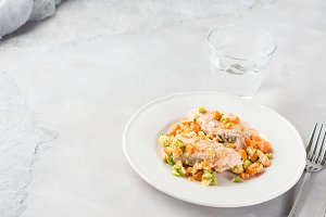 Steamed salmon with vegetables. Copy space