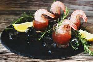 appetizer of shrimp cocktail with rosemary and sauce, selective focus