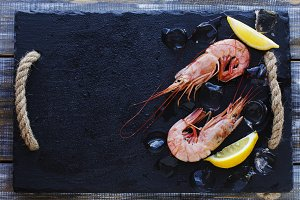 raw prawns with lemon and ice, selective focus