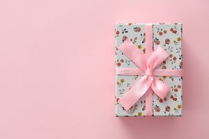 Floral pattern gift box on pink background