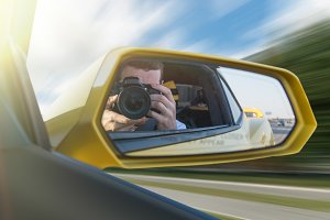 Photographer in speedy car