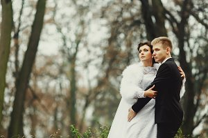 Bride and groom in an autumn park