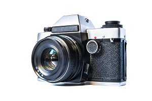 Retro film camera isolated on white