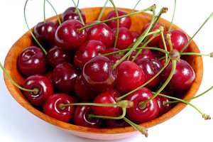 Red cherries in a wooden bowl