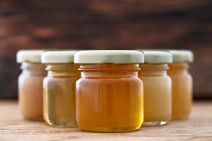 Different kinds of honey in a row