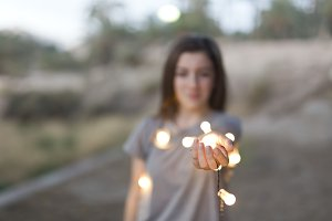 teenager with lights focused hands