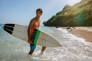 Handsome young man with surfboard