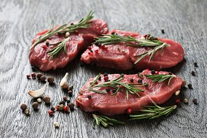 Raw beefsteaks with spices