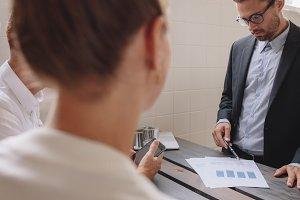 Male executive explaining