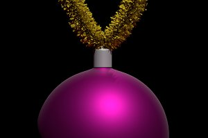 Christmas ball hanging on tinsel