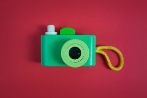 Cute Camera on Red Background